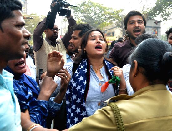 """Kolkata: Youth Congress workers stage a demonstration against the film """"The Accidental Prime Minister"""" at Hind Cinema near central Kolkata's Chandni Chowk area on Jan 11, 2019. (Photo: Kuntal Chakrabarty/IANS)(Image Source: IANS News)"""
