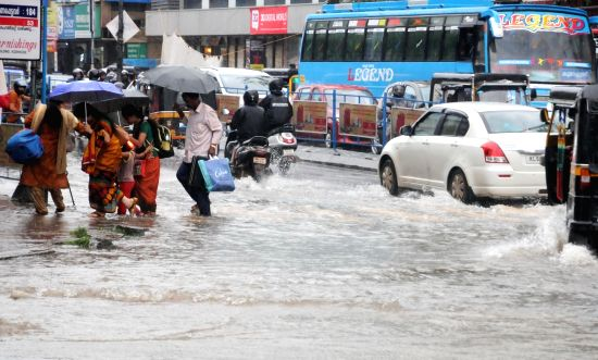 :Kozhikode: A view of flooded streets of Kozhikode of Kerala after heavy rains lashed the city on Aug 14, 2018. For a second successive day, heavy rains lashed Kerala's Kozhikode, Malappuram ...(Image Source: IANS)