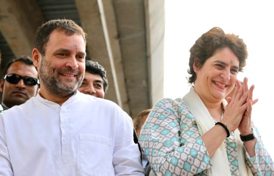 Lucknow:  Congress President Rahul Gandhi and his sitser Priyanka Gandhi Vadra during a road show in Lucknow on Feb 11, 2019. (Photo: IANS/AICC)(Image Source: IANS News)