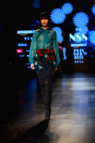 New Delhi: A model walks the ramp showcasing fashion designer Pallavi Mohan's creation during the second day of Amazon India Fashion Week in New Delhi on March 15, 2018. (Photo: Amlan Paliwal/IANS)(Image Source: IANS News)