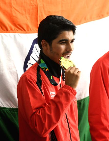 PALEMBANG, Aug. 21, 2018 - Saurabh Chaudhary of India reacts during the awarding ceremony of the men's 10m Air Pistol final  at the 18th Asian Games in Palembang, Indonesia on Aug. 21, 2018.(Image Source: Xinhua/Liu Ailun/IANS)