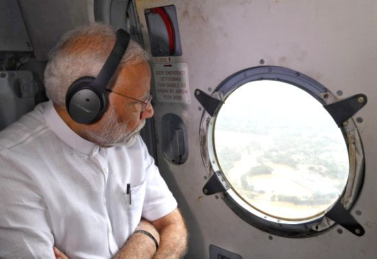 Prime Minister Narendra Modi conducts an aerial survey of flood affected areas, in Kerala on Aug 18, 2018.(Image Source: IANS/PIB)