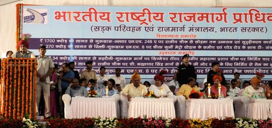 Union Minister for Road Transport and Highways and Shipping Nitin Gadkari addresses at the inauguration of the National Highway Projects in Gurugram on Aug 14, 2017. Also seen Haryana Chief ...