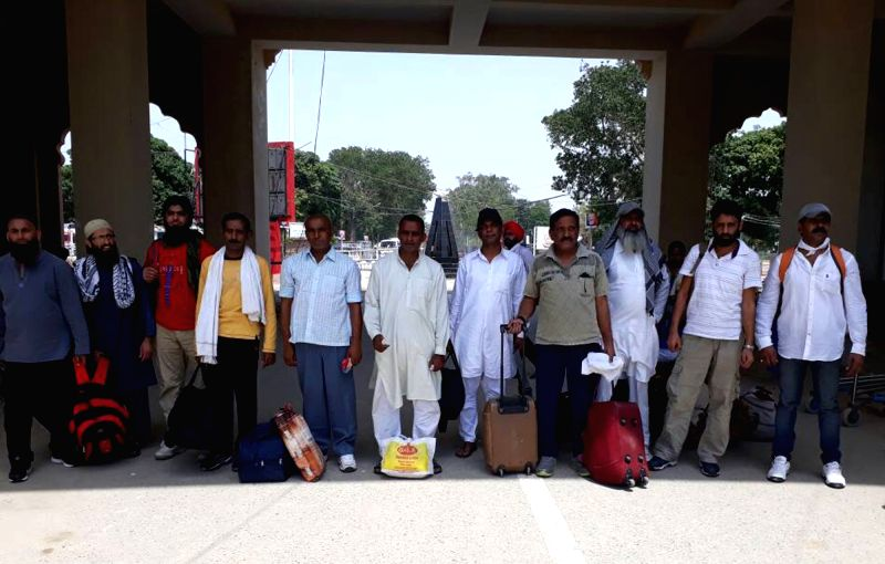 11 Pakistani prisoners who were released from Indian jails as a goodwill gesture head towards their homes via Attari-Wagha border near Amritsar in Punjab on June 12, 2017.