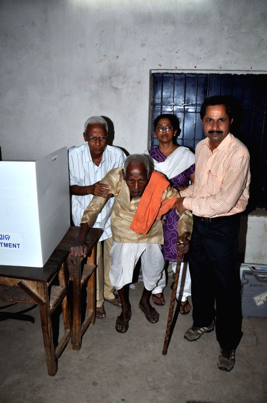 113 years-old Shatyabadi Behera comes out after casting his vote during the third phase of 2014 Lok Sabha Elections in Rourkela of Odisha on April 10, 2014.