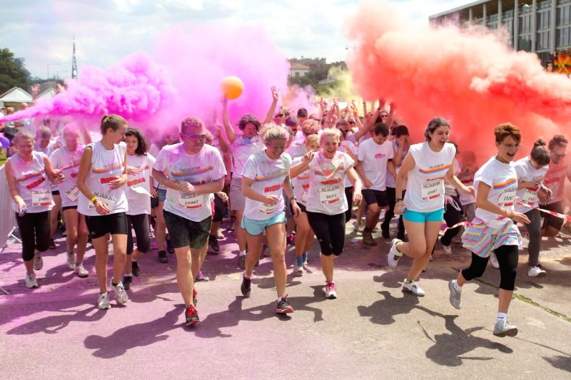Runners participate in the Color Run in Budapest, Hungary on June 22, 2014. The Color Run is a five-kilometer paint race, which is also a charity event