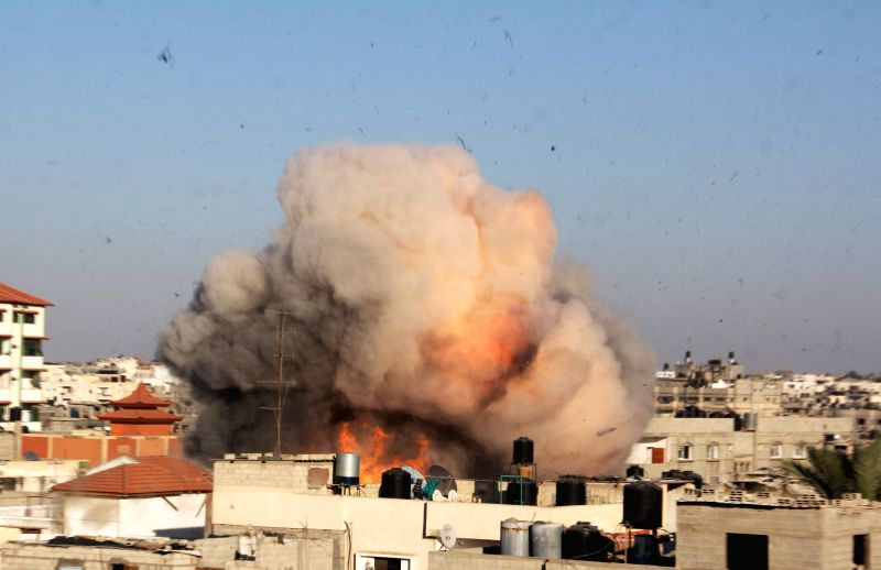 Photo taken on Aug. 26, 2014 shows an explosion caused by missile from an Israeli airstrike targeted the house of Palestinian senior Islamic Jihad leader ..