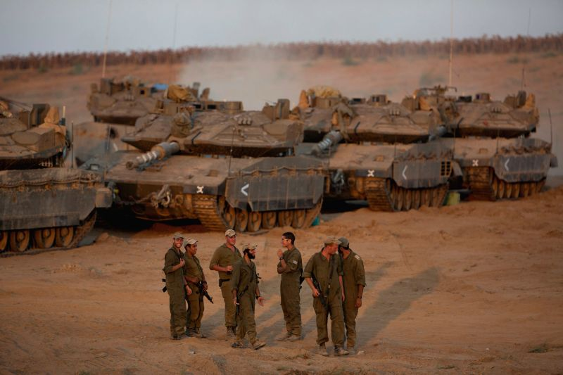 Israeli soldiers are seen at a deployment area in southern Israel bordering Gaza Strip, on Aug. 25, 2014. A spokesperson for the Israeli prime ...