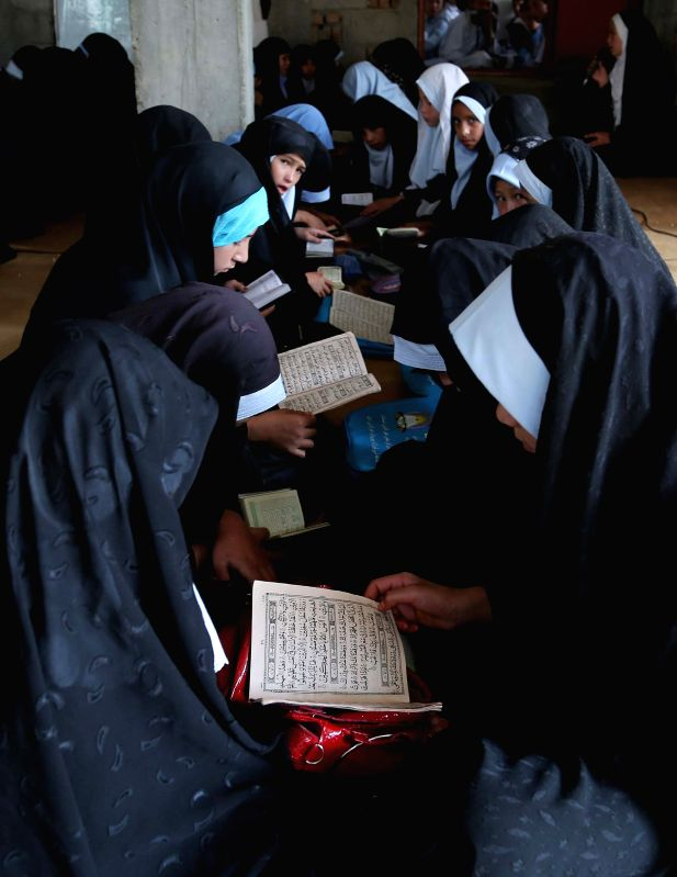 GHAZNI, Aug. 26 2014  --Afghan girls attend in class at a religious school in Ghazni province, eastern Afghanistan, on Aug. 26, 2014