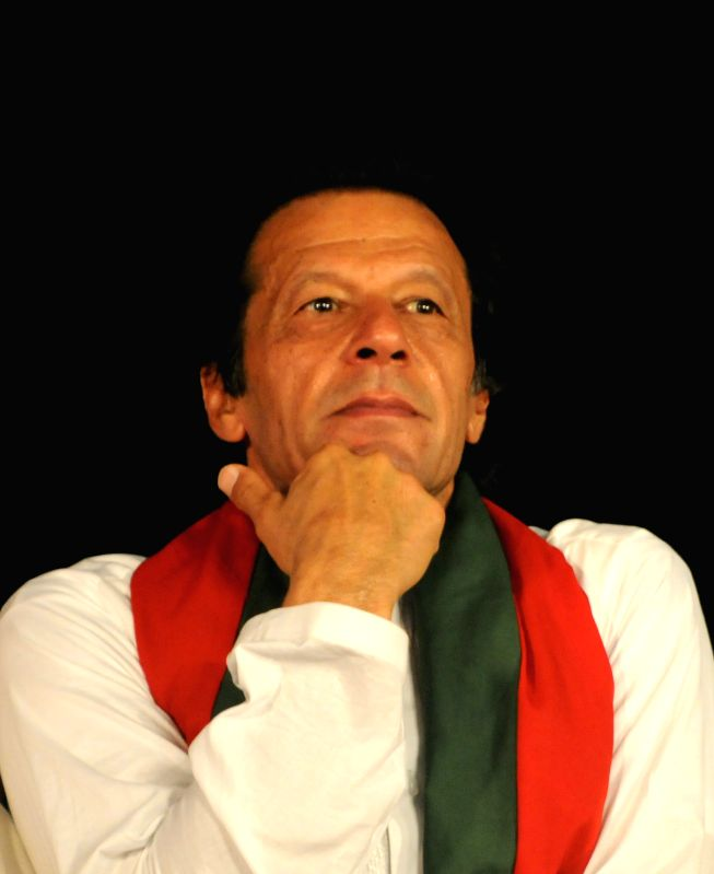 Pakistani opposition politician Imran Khan is seen during an anti-government protest in front of the Parliament building in Islamabad, capital of ...