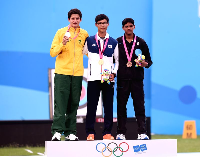 Gold medalist Lee Woo Seok (C) of Republic of Korea, silver medalist Marcus D'almeida(L) of Brazil and bronze medalist Atul Verma of India stand on the . - Atul Verma