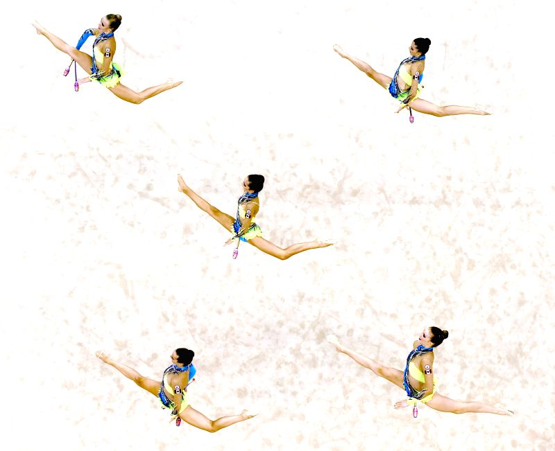 The athletes of Canada competes during the Group All-Around Qualification 5 Clubs match of rhythmic gymnastics event at the Nanjing 2014 Youth Olympic ..