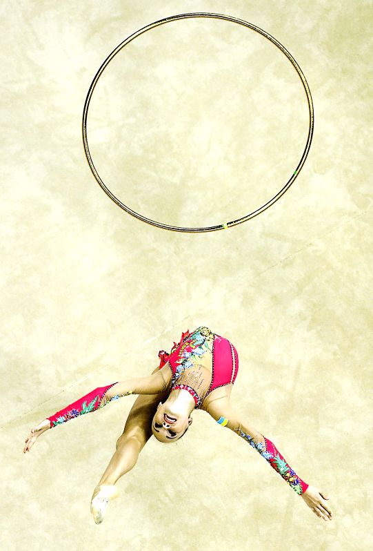 Valeriya Khanina of Ukraine competes during the Individual All-Around Qualification Hoop match of rhythmic gymnastics event at the Nanjing 2014 Youth ...