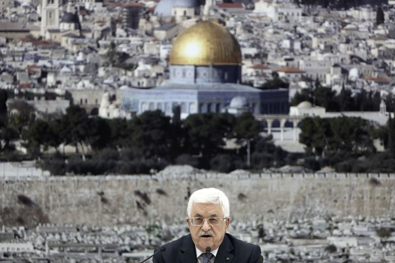 Palestinian President Mahmoud Abbas attends an urgent meeting for the Palestinian leadership in the West Bank city of Ramallah on Aug. 26, 2014. A new .