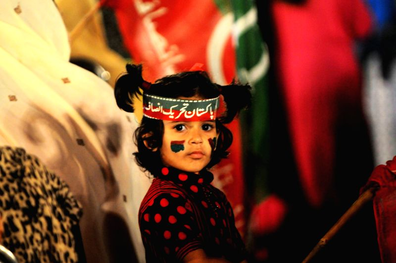 A supporter of opposition politician Imran Khan is seen during an anti-government protest in front of the Parliament in Islamabad, capital of Pakistan - Nawaz Sharif