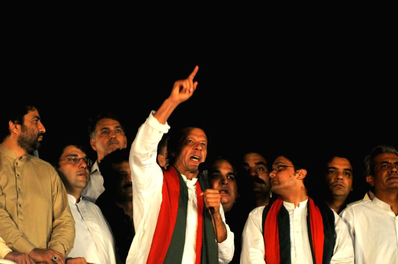 Pakistani opposition politician Imran Khan (C) addresses an anti-government protest in front of the Parliament in Islamabad, capital of Pakistan on ...
