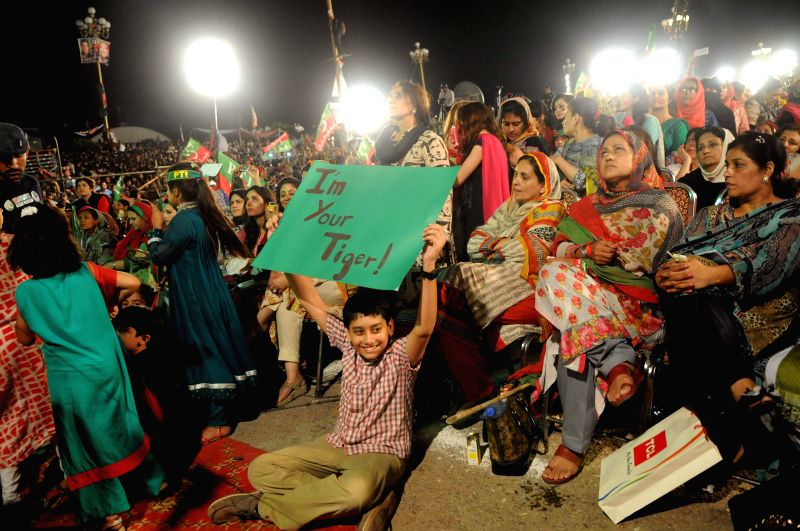 Supporters of opposition politician Imran Khan attend an anti-government protest in front of the parliament building in Islamabad, capital of ...