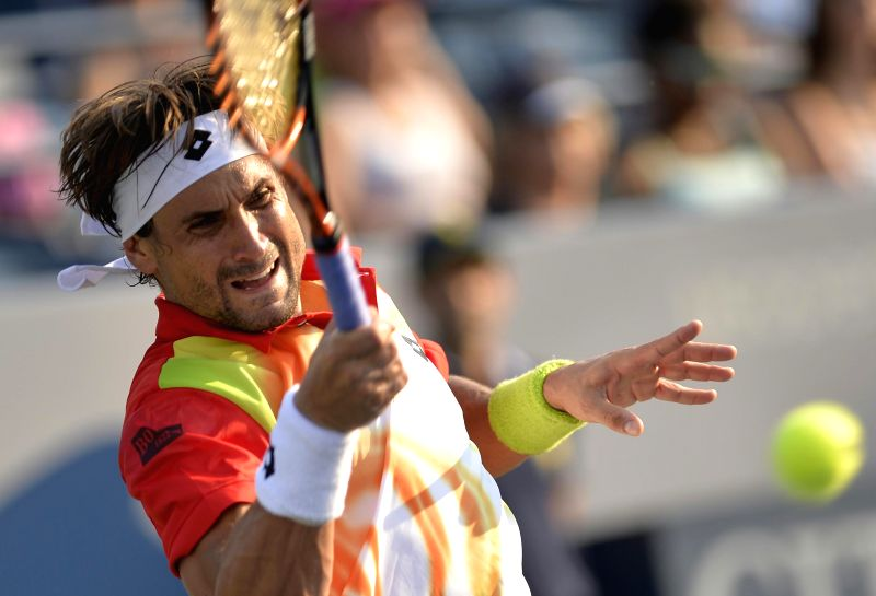 David Ferrer of Spain returns the ball during the men's singles 1st round match against Damir Dzumhur of Bosnia and Herzegovina at the U.S. Open tennis