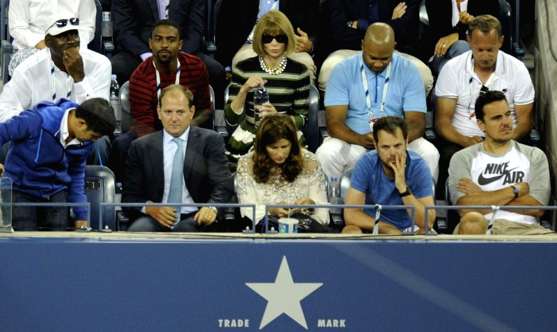 Michael Jordan (1st L Upper) and Anna Wintour (C Upper) watch the the men's singles 1st round match between Roger Federer of Switzerland and Marinko ...