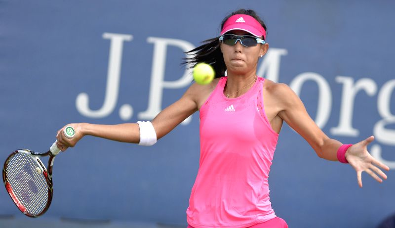 Wang Qiang of China returns the ball during the women's singles 1st round match against Paula Kania of Poland at the U.S. Open tennis tournament in New