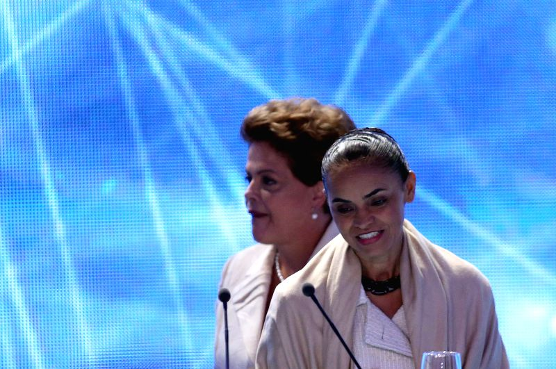 Brazil's President and presidential candidate of the Worker's Party Dilma Rousseff (Back) and presidential candidate of the Brazilian Socialist Party .