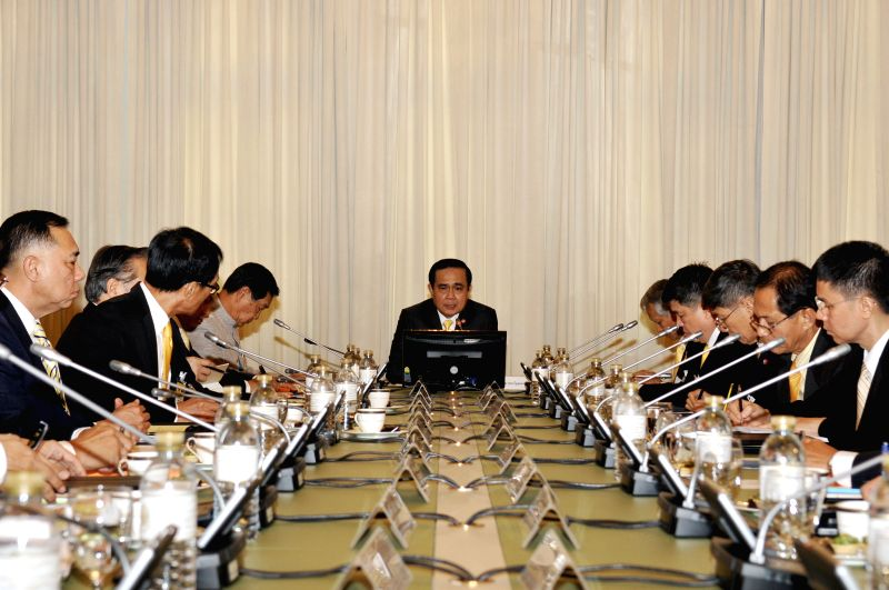 Thai Prime Minister Prayuth Chan-ocha (C) presides over Thai-US Human Trafficking meeting at Government House in Bangkok, Thailand, Dec. 24, 2014. ... - Prayuth Chan