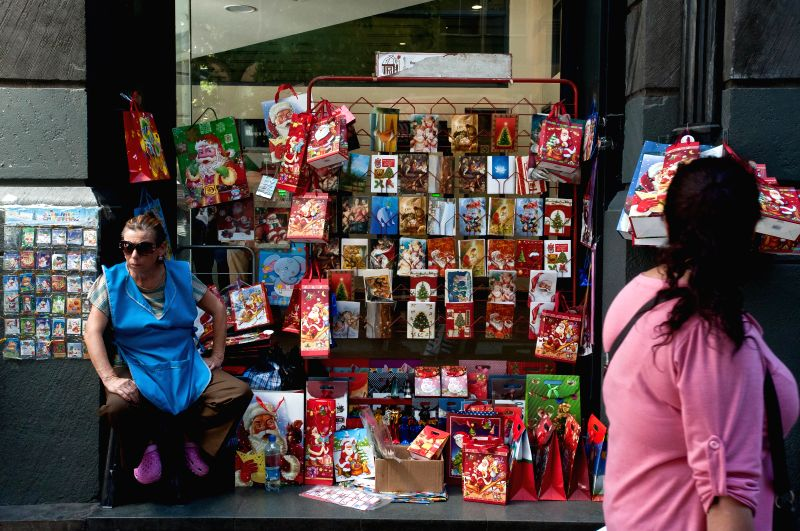 A person sells his Christmas products in Santiago, capital of Chile, on Dec. 23, 2014.