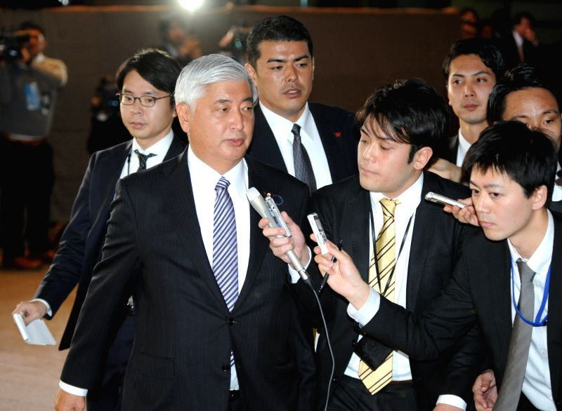 Newly-appointed Minister of Defence Gen Nakatani (L, front) enters the Prime Minister's official residence in Tokyo, Japan, Dec. 24, 2014. Japan's top ... - Shinzo A