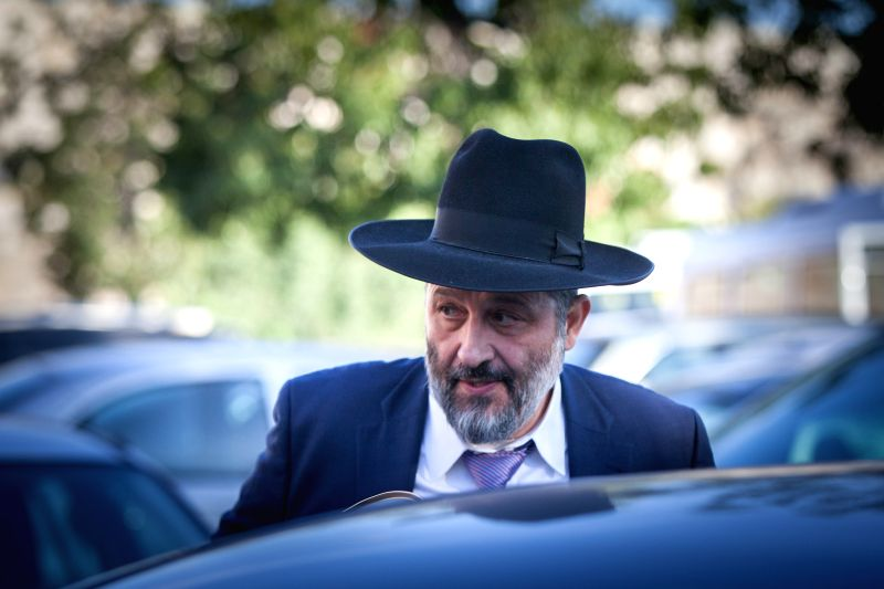 Israeli ultra-Orthodox Shas party leader Aryeh Deri leaves the house of Rabbi Shalom Cohen in the Old City of Jerusalem, on Dec. 30, 2014. Deri ...