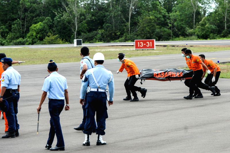 Search and Rescue (SAR) team members move the retrieved bodies from helicopter to ambulance at Iskandar Air Base, in Pangkalan Bun, Central ...