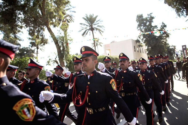 Iraqi newly graduated officers attend the ceremony of the 94th anniversary of the Army Day in Baghdad, Iraq, Jan. 6, 2015. Iraq's top military officials .