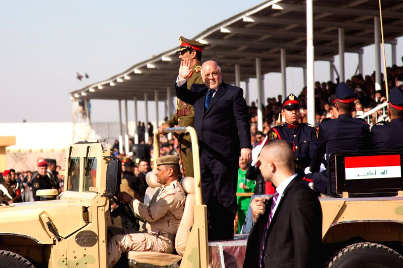 Iraqi Prime Minister Haider al-Abadi (C) attends the ceremony of the 94th anniversary of the Army Day in Baghdad, Iraq, Jan. 6, 2015. Iraq's top military - Haider