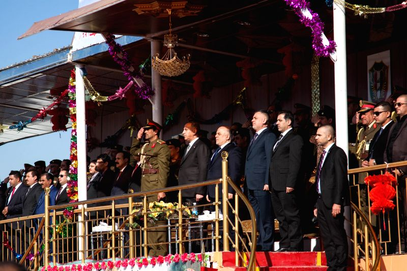 Iraqi Prime Minister Haider al-Abadi (front line, C) attends the ceremony of the 94th anniversary of the Army Day in Baghdad, Iraq, Jan. 6, 2015. Iraq's . - Haider