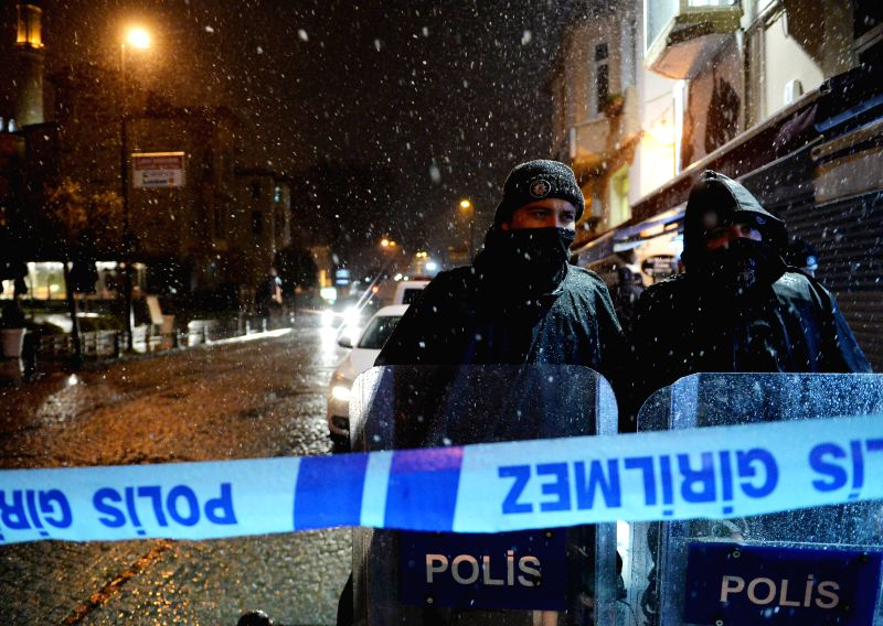 Policemen stand on alert outside the accident site in Istanbul, Turkey on Jan. 6, 2015. Two people were killed and one injured in a suicide bombing in ..
