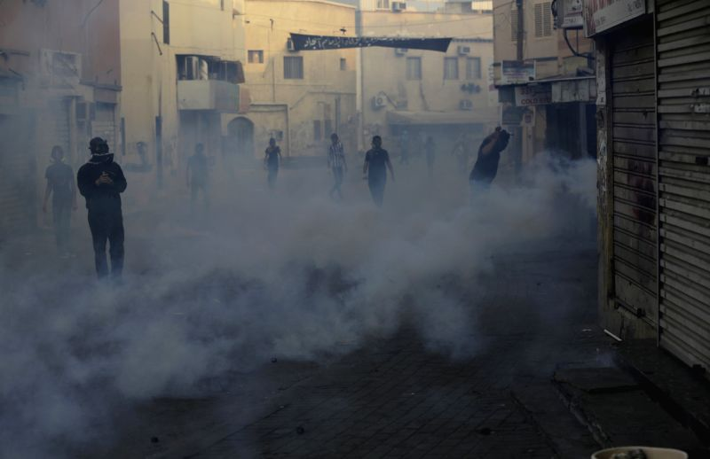 Bahraini anti-government protesters clash with policemen in Bilad Al Qadeem, a suburb of Manama, Bahrain, Jan. 5, 2015. Protesters demanded to free Jailed