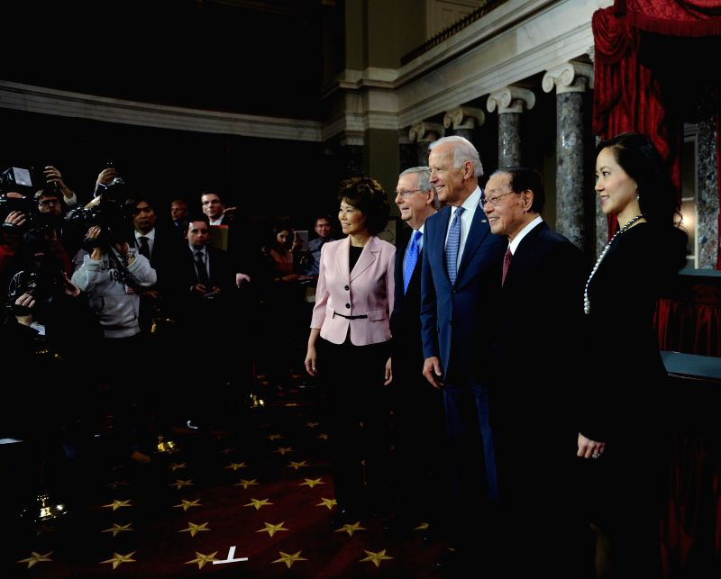 Mitch McConnell(4th R), new leader of U.S. Senate's majority and his family pose with Vice President Joseph Biden (3rd R) after swearing-in ...