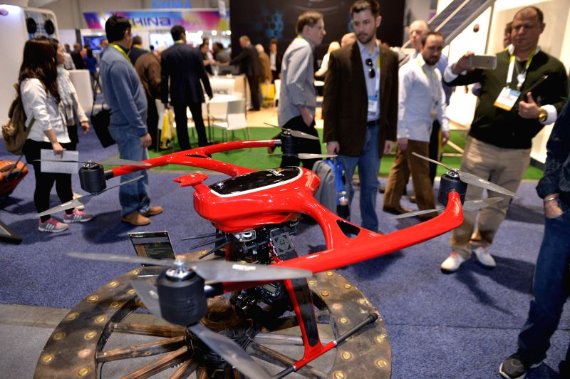 A Chinese company displays its drone which can carry professional cameras and lenses at the 2015 International Consumer Electronics Show (CES) in Las ..