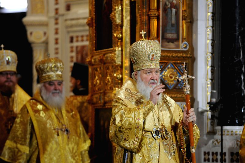 Russian Orthodox Patriarch Kirill (C) leads the Orthodox Christmas service at the Christ The Saviour Cathedral in Moscow, capital of Russia, on Jan. 7, 2015.