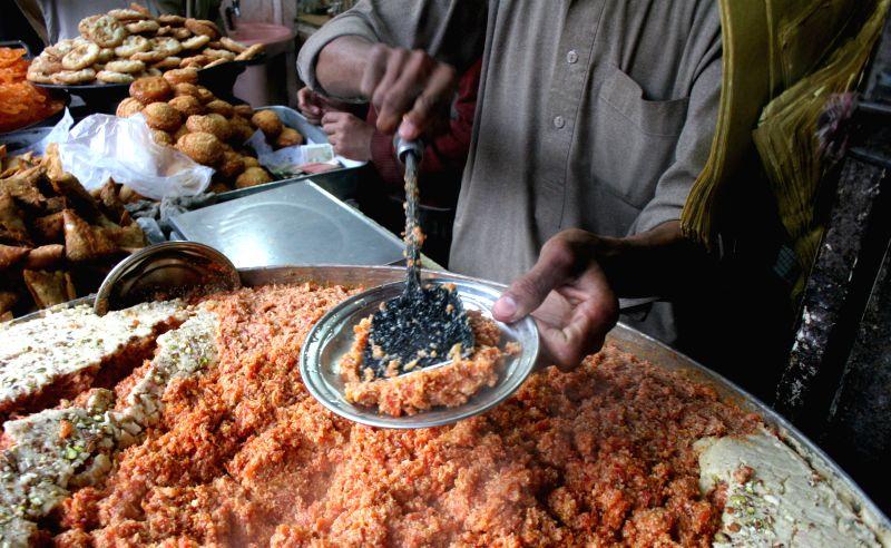 "A Pakistani vendor prepares sweet dessert locally called ""carrot halwa"" or ""gajerela"" in northwest Pakistan's Peshawar, Jan. 7, ..."