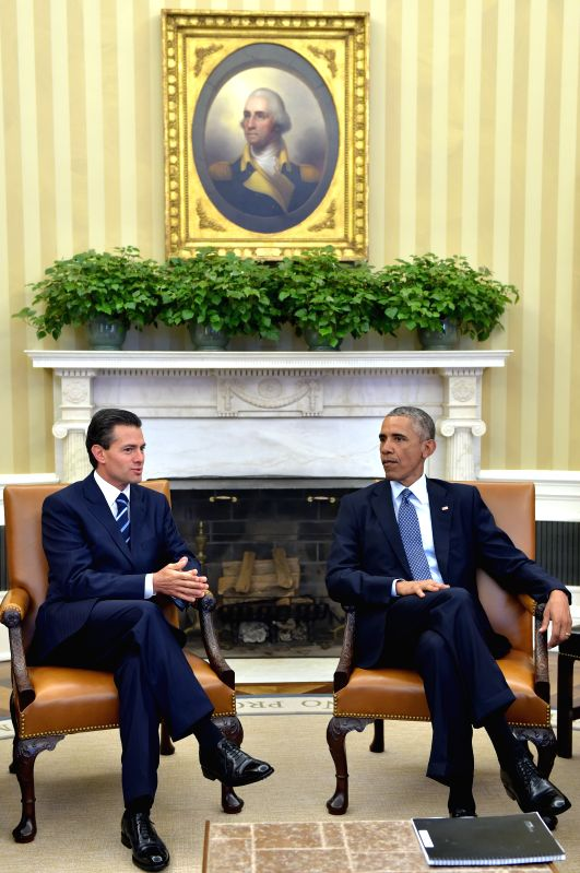 WASHINGTON, D.C., Jan 7, 2015 Image provided by Mexico's Presidency shows Mexican President Enrique Pena Nieto (L) meeting with his U.S. couterpart Barack Obama at the White ..