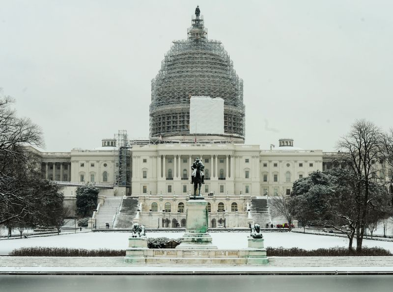 The image shows U.S. Capitol after a snowfall in Washington D.C., the United States, Jan. 6, 2015. The first snowfall of this winter hit ...