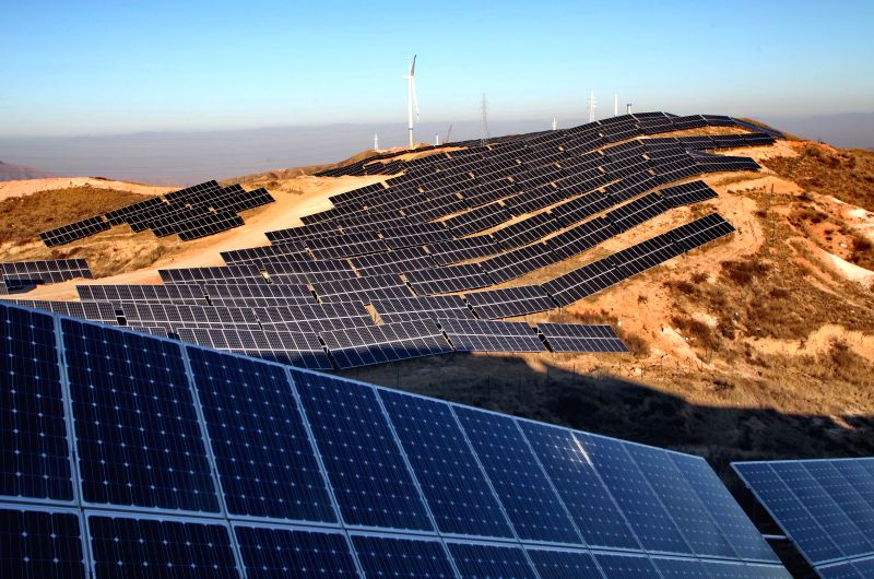 Photo taken on Jan. 2, 2015 shows solar and wind power facilities at a power plant in Zhangjiakou, north China's Hebei Province.  China's total ...