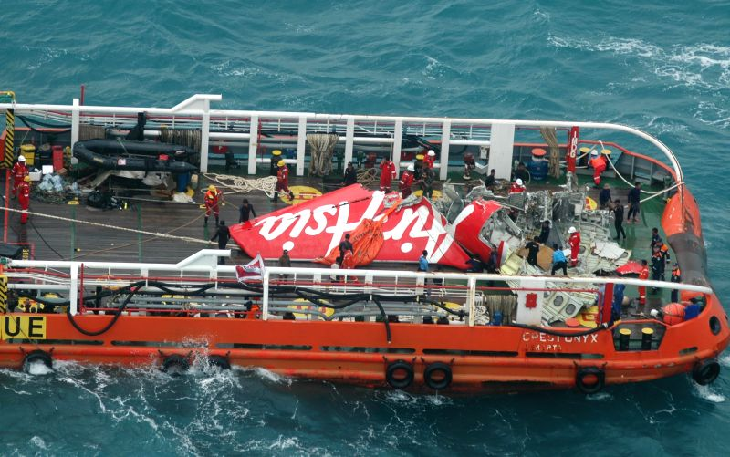 The tail section of crashed AirAsia flight QZ8501 is hoisted from the Java Sea, in Indonesia, Jan. 10, 2015. The tail section of crashed AirAsia ...