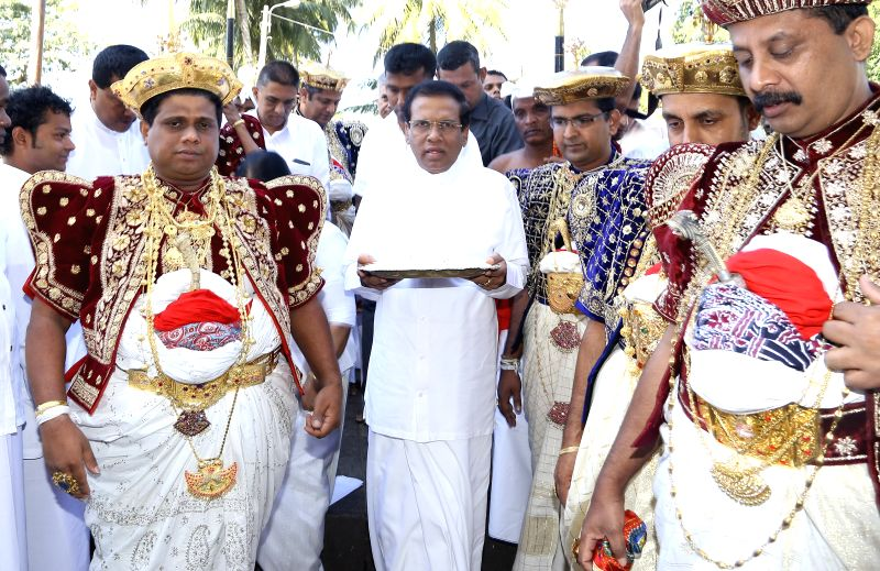 New President Maithripala Sirisena of Sri Lanka visits the Temple of Tooth in Kandy, Sri Lanka, on January 11, 2015.  In Sri Lanka where 70 percent of ...