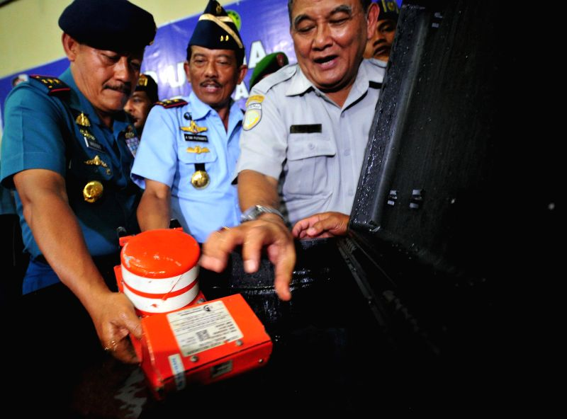 The cockpit voice recorder (CVR) is shown to media at Iskandar air force base, Pangkalan Bun, Central Borneo, Indonesia, Jan. 13, 2015. A senior ..