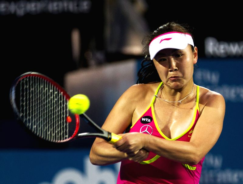 Peng Shuai of China returns the ball during the women's singles second round match against Petra Kvitova of the Czech Republic at the Sydney ...