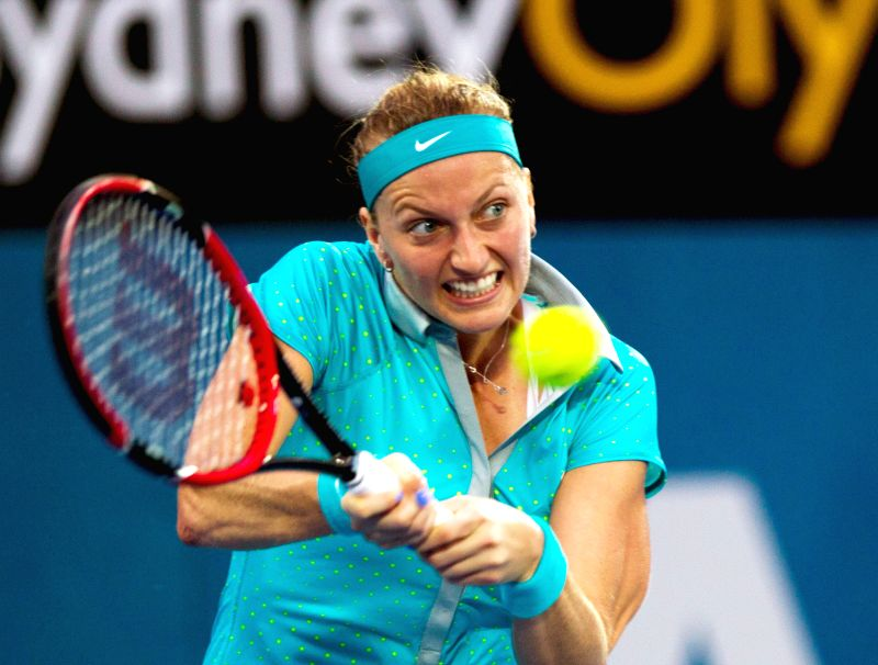 Petra Kvitova of the Czech Republic returns the ball during the women's singles second round match against Peng Shuai of China at the Sydney ...