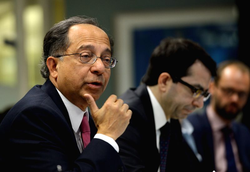 Kaushik Basu (front), World Bank chief economist and senior vice president, speaks to the press at the World Bank headquaters in Washington ... - Kaushik Basu