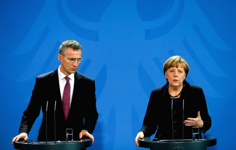 German Chancellor Angela Merkel (R) and visiting NATO Secretary General Jens Stoltenberg attend a press conference after their meeting at the Chancellery