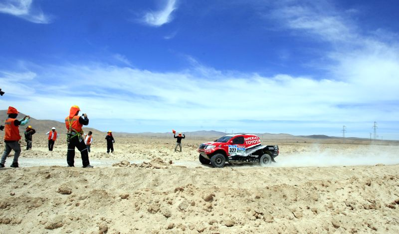 Leeroy Poulter and Robert Howie of South Africa race during the ninth stage of the Dakar Rally 2015, between the cities of Iquique and Calama, in the ...